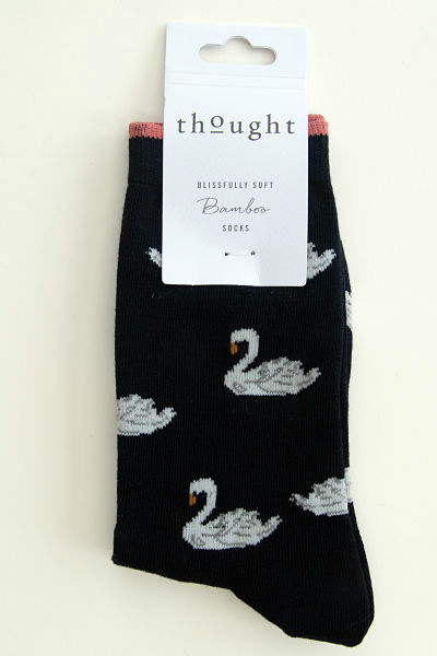 Swans glide on a black sock with just a touch of salmon colour at the top of the cuff