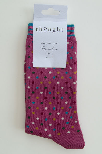 Dark pink socks with small spots in white, turquoise, brown and black. Cuff has thin turquoise stripes