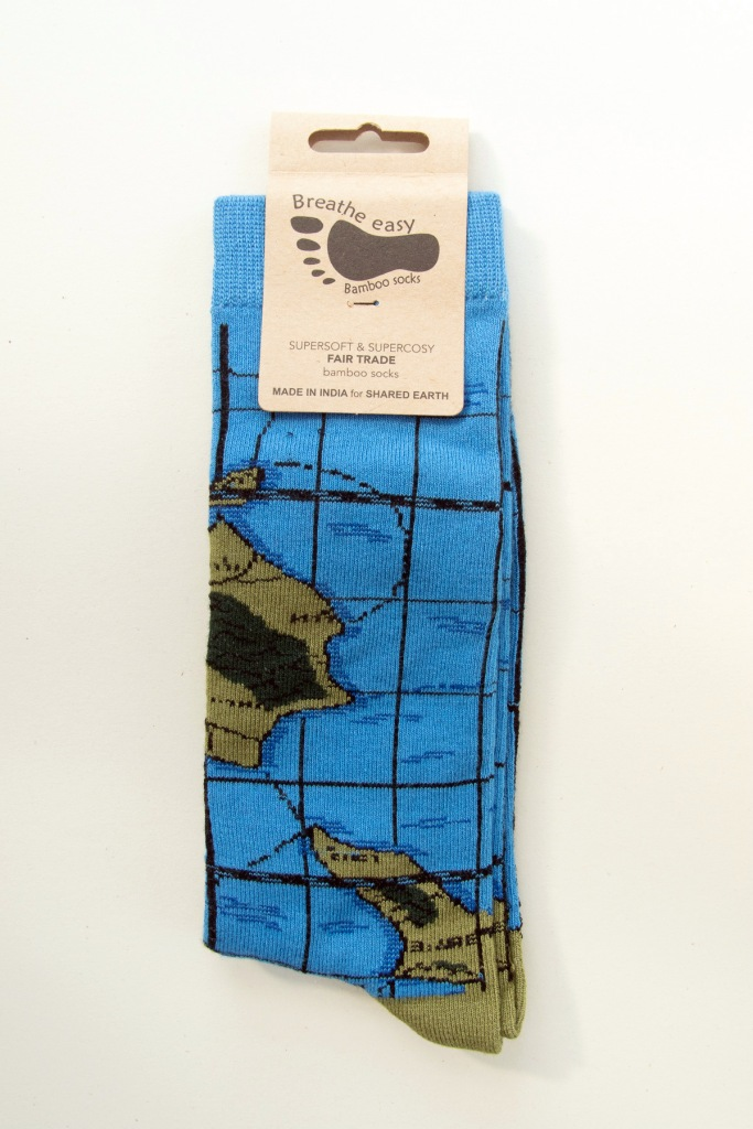 Islands in sage green and black and sea routes in black on a sea blue sock with sage green toes and heels.