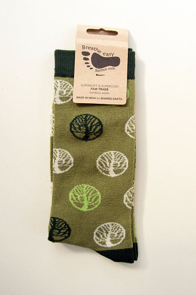 Tree of life design. Trees are light green or cream or black on a sage green sock with dark green toes, heels and cuffs.