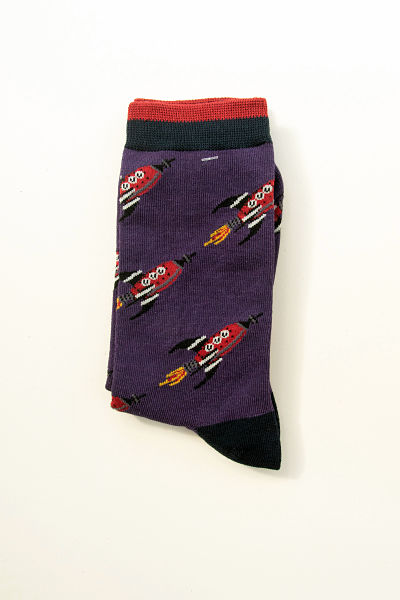 Red rockets flame across a dark purple sock. Black heels and toes. Black cuff with red edge to the top which matches the rockets.