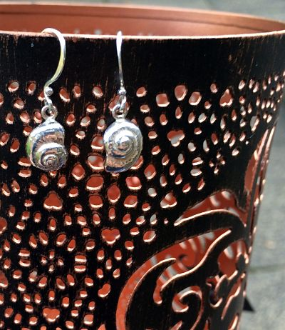 Sterling silver worked into a coiled shell shapes suspended on silver hooks.