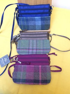 Pouch Bags in a wool tweed for the body of the bag with a stain top section surrounding the zips, satin strap and satin lined compartments,